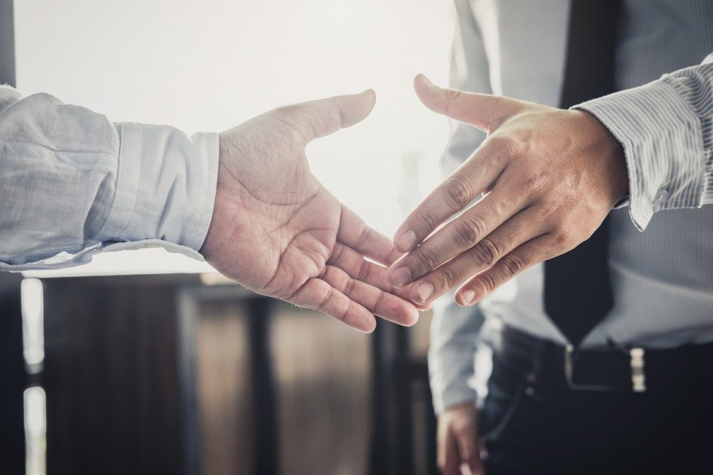 Man shaking hands with the guarantor