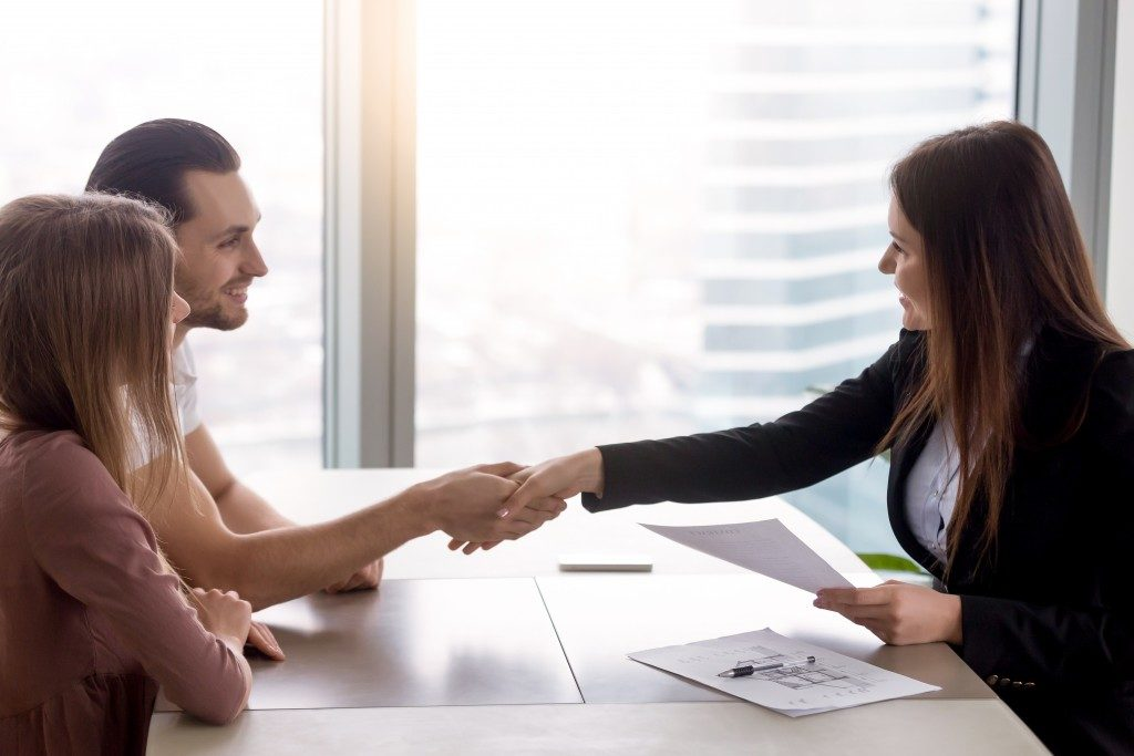 tenant shaking hands with landlord