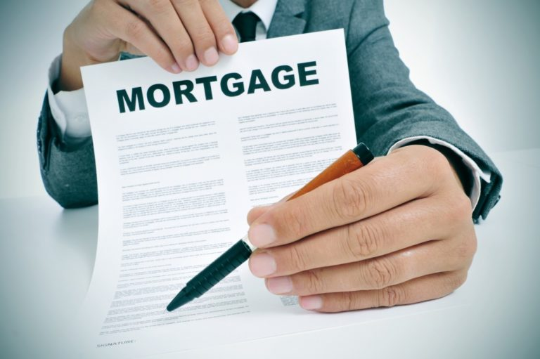 Man holding a mortgage contract