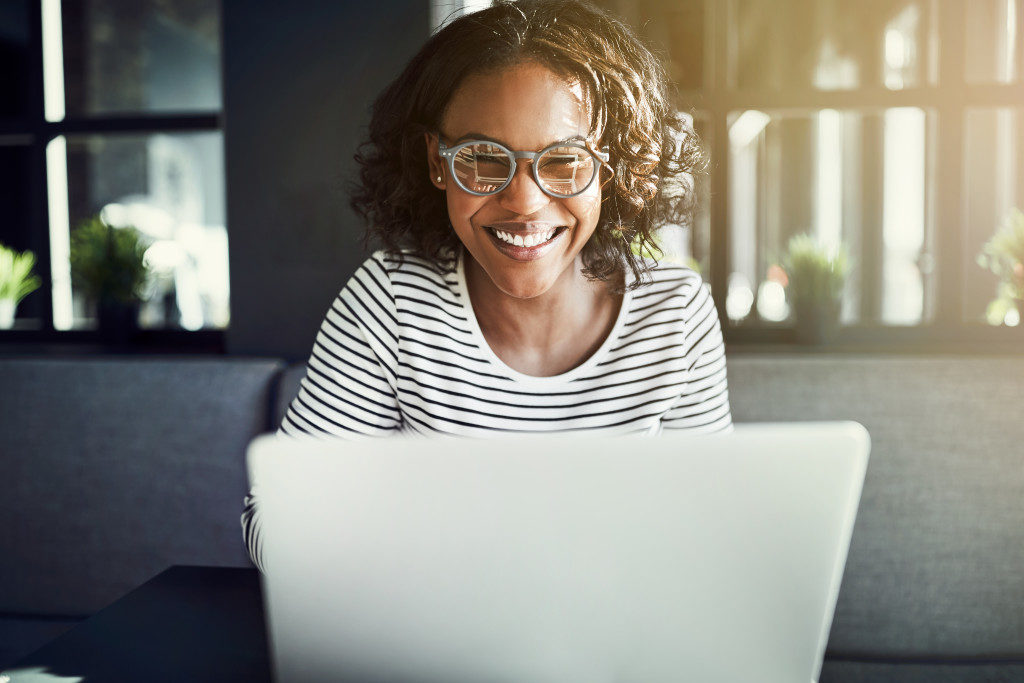 Happy female using laptop